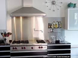 kitchens with stainless steel backsplash behind stove stainless steel backsplashes room by room the