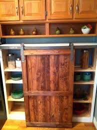salvaged desk turned coffee and beverage bar kitchen cabinets