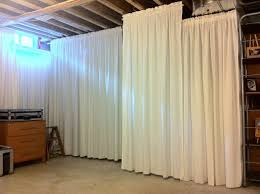 Hang Curtain From Ceiling Decorating Houseonashoestring Hang Curtains In Unfinished Basement