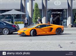 Lamborghini Aventador Coupe - orange lamborghini aventador coupé being parallel parked in front