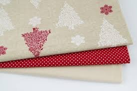 100 white bordeaux christmas trees on a linen background