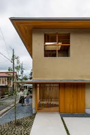 hearth architects completes family house in shiga with tree