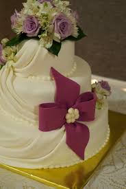 country cupboard cakes ivory wedding cake with mauve bow