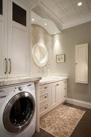White And Gray Laundry Room Features White Cabinets Paired With - Utility sink backsplash