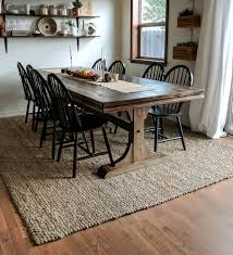 dining table with rug underneath jute rug review an honest review joyfully growing blog