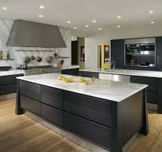 white granite fitting kitchen worktops with black painted storage