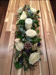 table runner made with avalanche roses baby blue eucalyptus