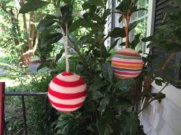 celebrating christmas in july with yarn wrapped ornaments for