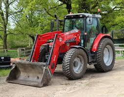 file a massey ferguson front loader tractor in the woodyard at