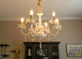 Brass Chandelier Makeover Update A Brass Chandelier With White Paint Fabric And Crystals