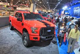 2014 las vegas truck show sema ford floods the show floor with f 150s pickuptrucks com news