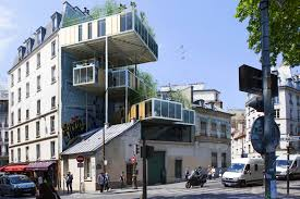 parasitic prefabs mounted atop buildings create affordable green