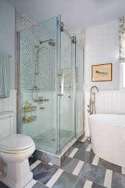 bathroom with corner glass shower stall and freestanding tub