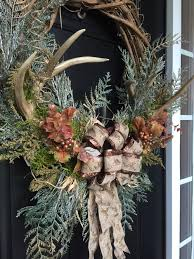 rustic fall or winter wreath with antlers in a grape vine wreath