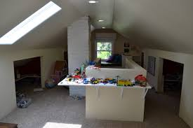 kids play room in the attic with table wall mounted and open