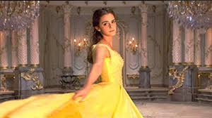 first look at emma watson as belle in iconic yellow gown in beauty