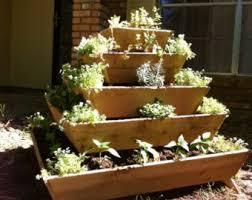 un assembled pyramid planter herb garden strawberry planter