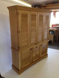 hand crafted media cabinet with louver doors by john callentine