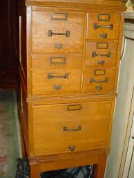 brown color oak file cabinet with 1 large drawer 2 medium drawers