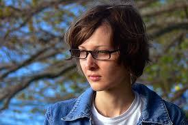 christine woman portrait jeans jacket glasses short hair