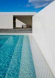 A white chevron patterned pool house Why not