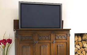 auto raising tv cabinet screen breaks how to hide or disguise your flat screen tv telegraph