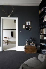 room with black walls dramatic living room with black walls interior design