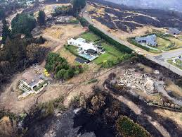Wildfire Fighting Boots by Homeowner Turned His Sprinklers On Before Leaving To Escape A