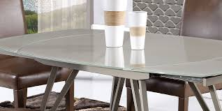 modern champagne glass swivel extension dining table with brown