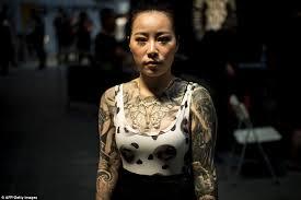 chinese men and women at langfang international tattoo show