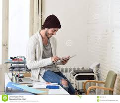 how to look happy young trendy businessman in beanie and cool hipster informal look