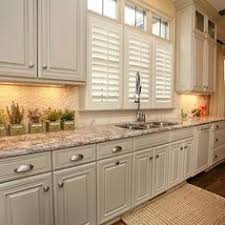 painted kitchen cabinet images taupe kitchen cabinets love the dark stain color on the island
