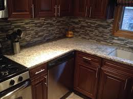 giallo ornamental light granite kitchen with cabinetry wood
