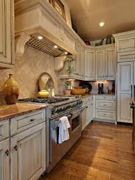 rustic white kitchen cabinets distressed white kitchen cabinets for paigelooks great with the
