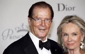 roger moore entertainment world pays tribute to roger moore following iconic