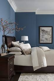 bedroom simple light blue bedcover and white chrome table lamp
