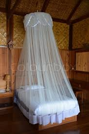 mosquito net for bed mosquito net on bed myanmar style stock photo colourbox