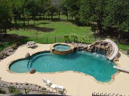 Backyard Pool Images by Elaborate Pool Featuring Large Grotto Waterfall And Tube Slide