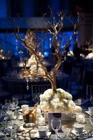 Tree Branch Centerpiece by Tree Branch Centerpiece With Delicate Flowers For An Enchanted
