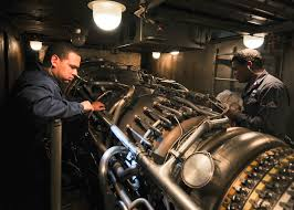 file us navy 110215 n 9793b 015 sailors check a gas turbine engine