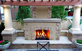 formal outdoor fireplace with brick and stone and arbor in