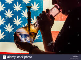 State Flags For Sale Man Smoking Bong With American Marijuana Flag In Background Stock