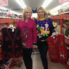 filming stretch your dollar ugly christmas sweater segment at