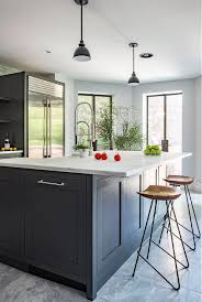 dark gray kitchen island with honed white marble countertop and