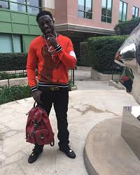 gucci mane sweater gucci mane wears a paul smith dinosaur intarsia sweater carries
