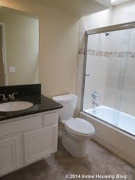 Open House Review  Varesa Irvine Housing Blog - Black granite with white cabinets in bathroom