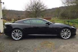 aston martin blacked out the aston martin db9 gt and the incoming db11
