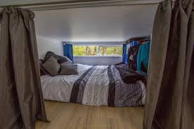 shipping container homes interior lower mezzanine and bed in 110 square foot shipping container home