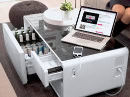this futuristic coffee table lets you refrigerate food play music and charge your phone at the same time jpg