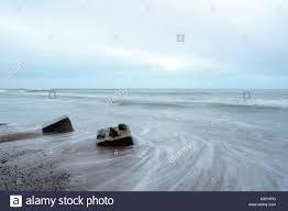 old abandoned world war two tank traps left on the beach near